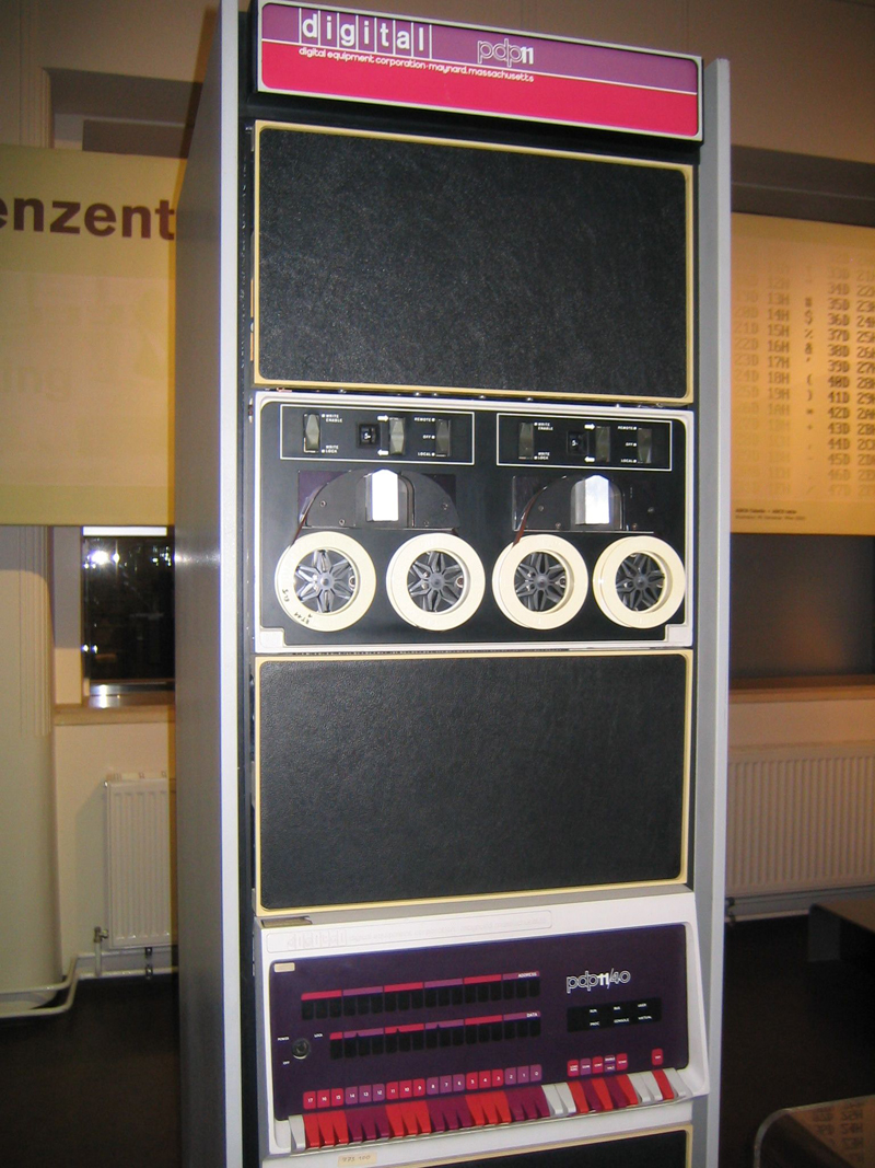 PDP 11 minicomputer. Microprocessors finally allowed machines of this size to be replaced by microcomputers.
